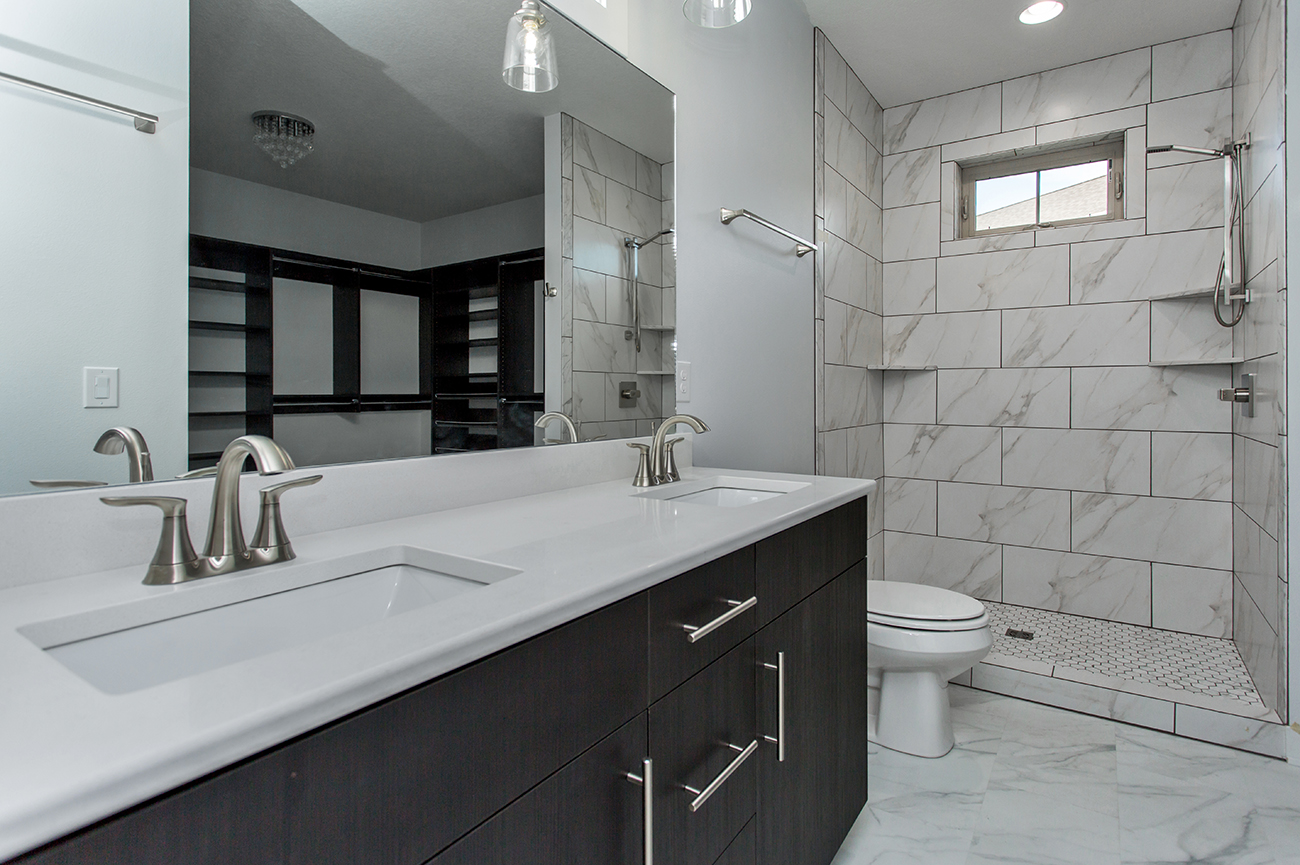 Custom Home Builder in Iowa. White Marble Bathrooms. Central Iowa Renovations. Custom Home Builder.